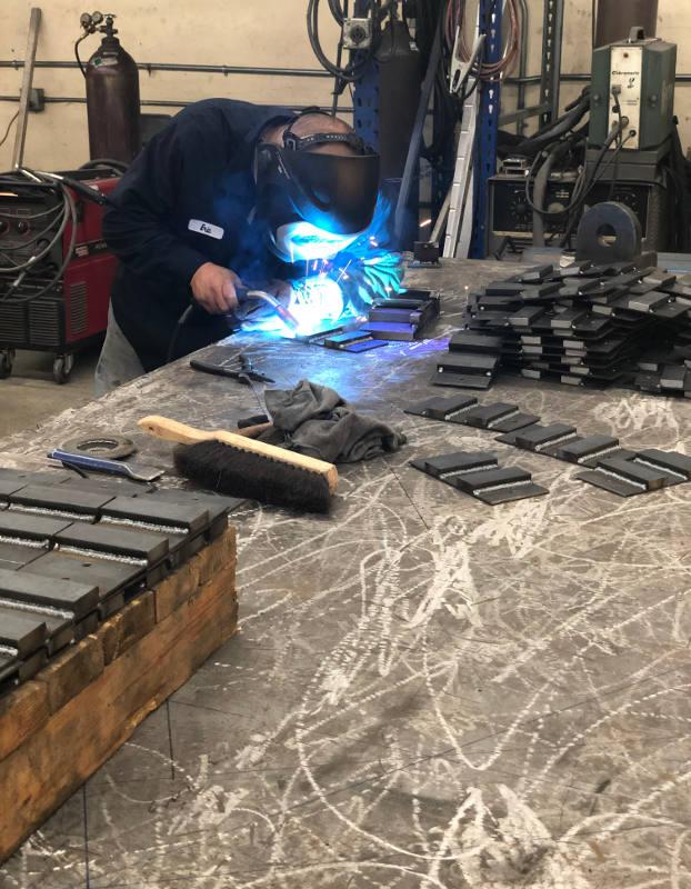 employee welding metal